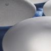瑞士调节器对纹理乳房植入物进行称重